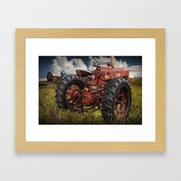 Abandoned Old Farmall Tractor in a Grassy Field on a Farm Framed Art Print