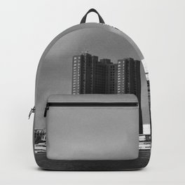 stormy waterfront Backpack