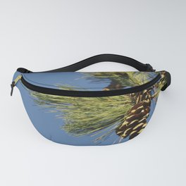 Pine cones and branches against a blue autumn sky Fanny Pack