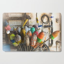 Colorful Fishing Floaters in a Barrel Cutting Board
