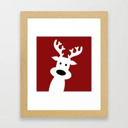 Reindeer on red background Framed Art Print
