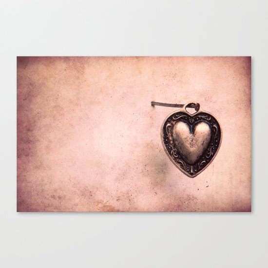Hanging on a nail Canvas Print
