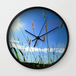 Sun through the weeds Wall Clock