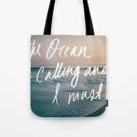 leah flores Tote Bags featuring The Ocean is Calling by Laura Ruth and Leah Flores  by Laura Ruth