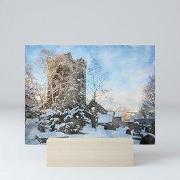 snowy winter churchyard Mini Art Print