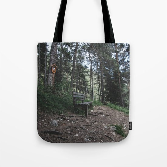 Resting bench on hiking trail in the Alps Tote Bag
