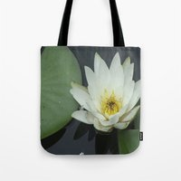 rileigh smirl Tote Bags featuring Water Lilly by Rileigh Smirl