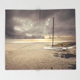 Dramatic sunrise on the beach Throw Blanket