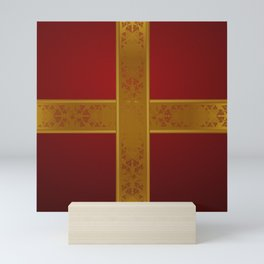 Gift Wrapped -- gold ribbon around a red present. Mini Art Print