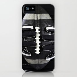Gloved hands holding an American Football iPhone Case