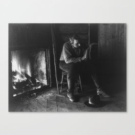 Vintage Adirondacks: Man Reading by the Fireplace Canvas Print