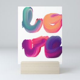 l-o-v-e brightly coloured painted lettering Mini Art Print