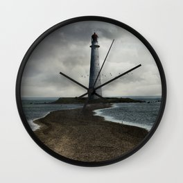 Cloudy seascape with an older lighthouse Wall Clock