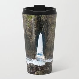A Wave Crashes Through Arch Rock Travel Mug