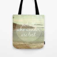 not all who wander are lost Tote Bags featuring Not All Who Wander Are Lost by Jillian Audrey