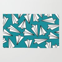 planes Area & Throw Rugs featuring Paper Planes by Amy Harlow
