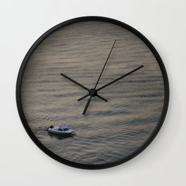Small boat anchored in the river Wall Clock