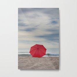 Red umbrella lying at the beach Metal Print