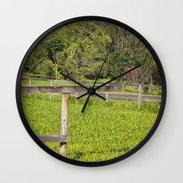 Broken fence in a rural area Wall Clock