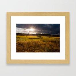 Breathtaking sunset above meadow Framed Art Print