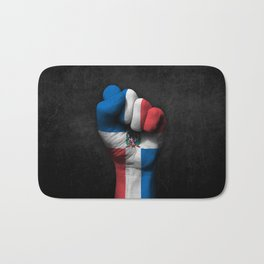 Dominican Flag on a Raised Clenched Fist Bath Mat