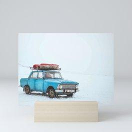 Blue Sedan on Snow at Daytime Mini Art Print