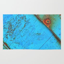 Blue rusty boat detail. Rug