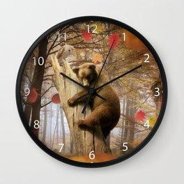 Brown bear climbing on tree Wall Clock