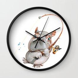 A hippopotamus fishing Wall Clock