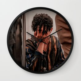 Young Man Listening to Music on the Metro, A Wall Clock