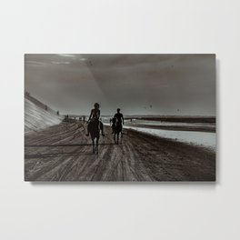 Young Couple Riding Horses at the Beach Metal Print