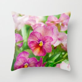 pansy in a garden Throw Pillow