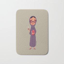 Young practical Emirati female holding coffee Bath Mat