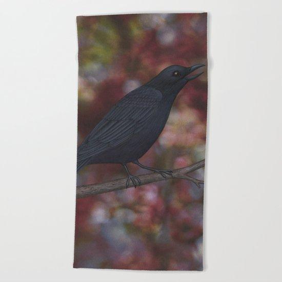 crow on a branch bokeh Beach Towel