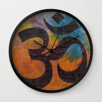 om Wall Clocks featuring Om by Michael Creese