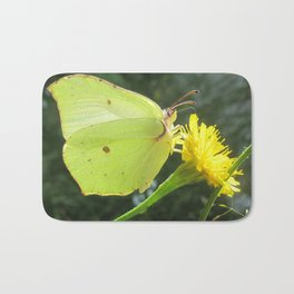 Brimstone butterfly and yellow flower Bath Mat