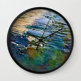 Colored sea waves licking the rock Wall Clock