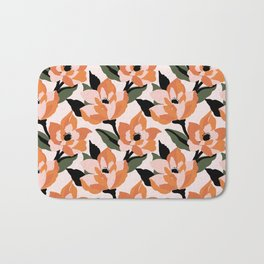 Bold orange poppy on a soft pink base Bath Mat