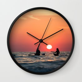 man woman boat rowing in sea Wall Clock