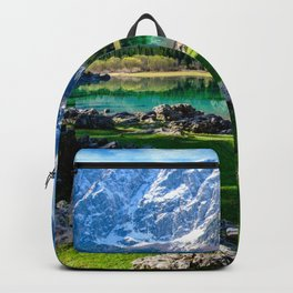 Spring morning at the alpine lake Backpack