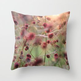 Grass with red flowers touched by the evening sun Throw Pillow