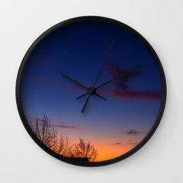 Sunset over the roofs Wall Clock