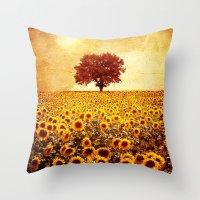 sunflowers Throw Pillows featuring lone tree & sunflowers field by Viviana Gonzalez