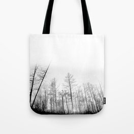 The black and white silhouette view of jungle trees Tote Bag