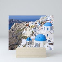 Blue domes of churches in Oia village, Santorini island, Greece Mini Art Print