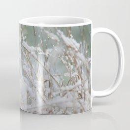 Snowflakes on dry grass Coffee Mug