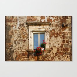 Antique window with red flowers Canvas Print