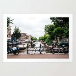Bicycles in Amsterdam canal Art Print