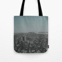 manhattan Tote Bags featuring Manhattan by Leah Flores