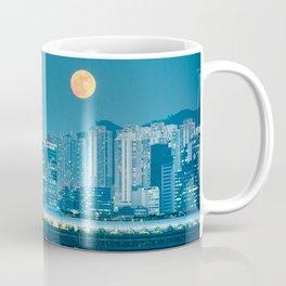 Super Moon over city skyline Coffee Mug